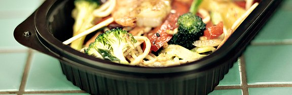 Noodle_dish_with_shrimp_and_brocolli_in_plastic_mold.jpg